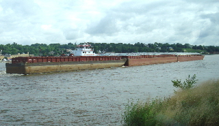 Tow_and_barges_on_Mississippi
